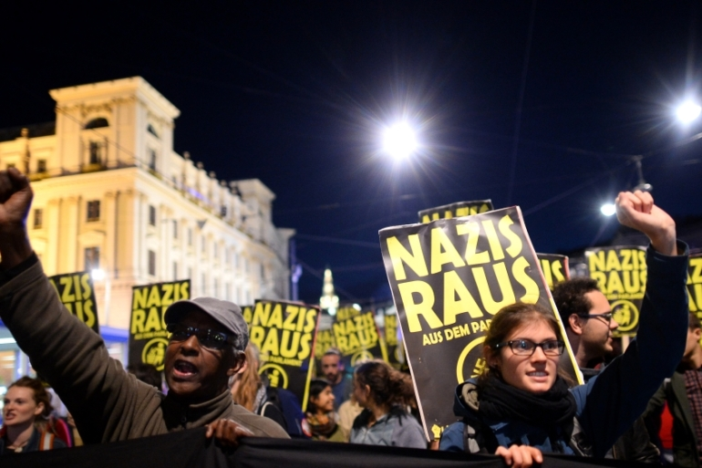 Demonstrators carry signs reading 'Nazis get out' during a protest in Vienna, Austria, where the far right has now entered government [File: Thomas Kronsteiner/Getty Images]