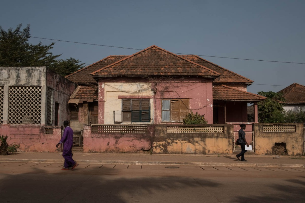 Many of the residences built in the capital, Bissau, during Portuguese rule are abandoned in the downtown area. [Ricci Shryock/ Al Jazeera]