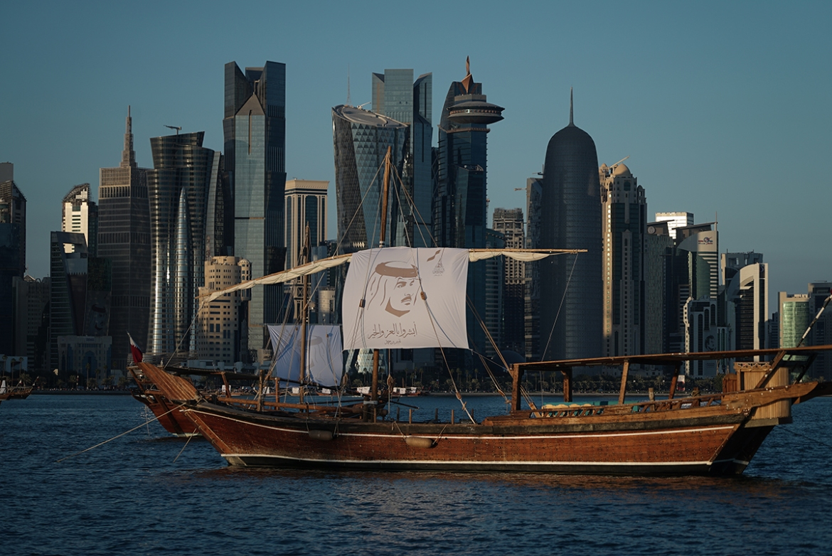 The dhows at Doha Corniche were decorated with the portrait of Qatar's Emir Sheikh Tamim bin Hamad Al Thani. [Sorin Furcoi/Al Jazeera]