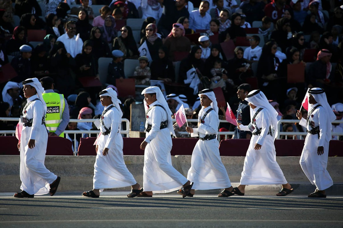 Thousands of people gathered along Doha's waterfront to celebrate Qatar's National Day. [Showkat Shafi/Al Jazeera]