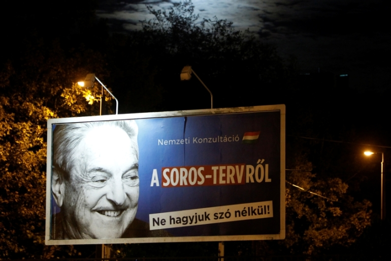 A government billboard is seen displaying George Soros  in October 2017 [Bernadett Szabo/Reuters]