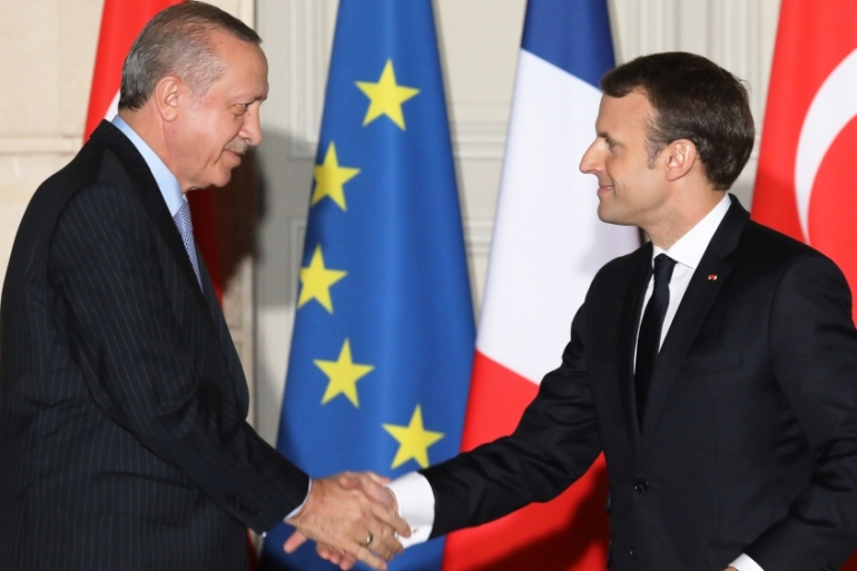 Macron (R) and Erdogan held talks in France's capital, Paris [Ludovic Marin/Reuters]