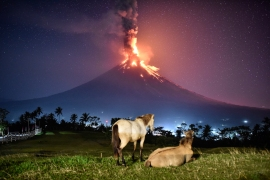 The Philippine Institute of Volcanology and Seismology raised the volcano's alert level to 4 out of 5 possible tiers after an eruption on Monday, January 22 spewed a huge column of ash five kilometres high. [Ezra Acayan/Al Jazeera]