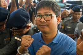 Reuters journalist Wa Lone is escorted by police upon arrival at court on Wednesday [Thein Zaw/AP]