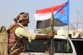 A bodyguard of a southern Yemeni separatist leader holds an RPG launcher as he rides on the back of a pick-up truck in Aden, Yemen January 28, 2018 [Fawaz Salman/Reuters]
