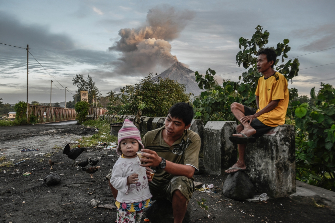 Locals are used to life near the volcano, but many admit the recent powerful eruptions made them feel uneasy. [Ezra Acayan/Al Jazeera]