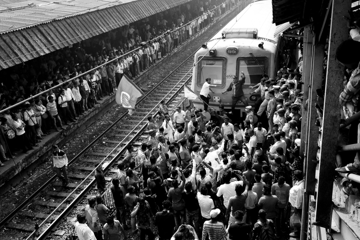 Protesters at Dadar station, one of the busiest in the city, temporarily managed to stop a local train, as others cheered them on from the platform, while hundreds of commuters watched. Demonstrators from many locations across Mumbai such as Panvel, Bandra, Kalyan, Thane, Vashi, Santacruz, Byculla and Worli had gathered at Dadar. [Hari Adivarekar/Al Jazeera]