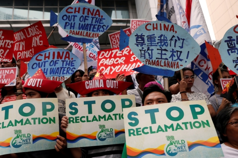 Activists protest Beijing's continued reclamation activities in the South China Sea [Reuters]