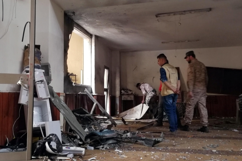 People inspect the damage inside the mosque in Benghazi [Reuters] t