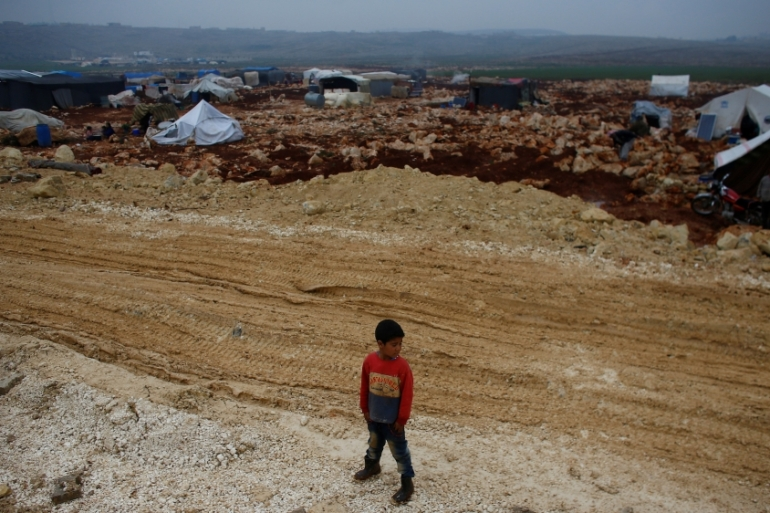 A displaced Syrian boy is pictured at Kelbit refugee camp, near the Syrian-Turkish border, on January 17, 2018. Picture [Osman Orsal/Reuters]