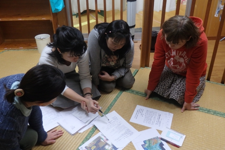 Mothers at the Midorigaoka nursery school discuss upcoming events for their campaign calling for a halt to US military flights over schools [Lisa Torio/Al Jazeera]