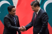 Maldives President Abdulla Yameen shakes the hand of China's President Xi Jinping after a signing meeting at the Great Hall of the People in Beijing, China [Fred Dufour/Reuters]