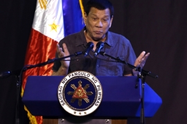 Duterte's spokesman said the president's jokes are 'funny' and that critics should lighten up [Jeoffrey Maitem/Getty Images]