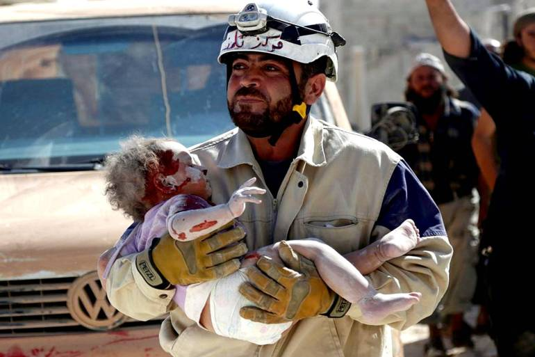 The White Helmets came to prominence in 2012 for their work rescuing those trapped in rubble after air raids by Syrian government and Russian warplanes [File: Reuters]