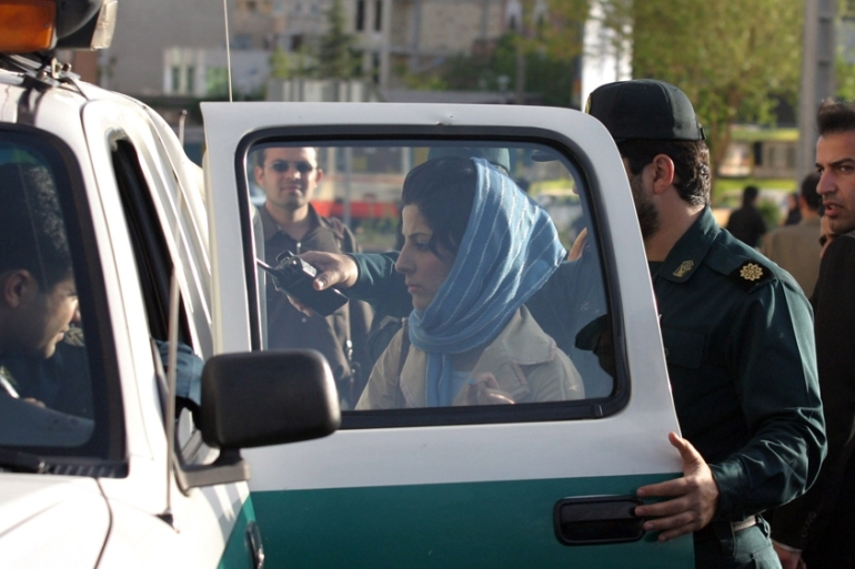 Iranian police officers detain a woman for not adhering to the dress code in Tehran back in 2007 [File: The Associated Press]