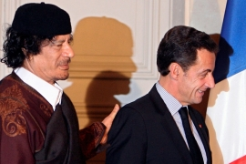 Sarkozy, right, was charged in 2018 with taking bribes, concealing the embezzlement of Libyan public funds and illegal campaign financing [File: Patrick Hertzog/Reuters]