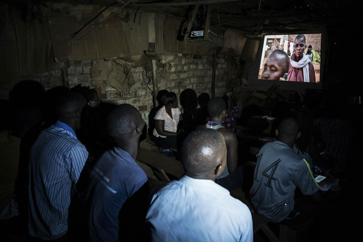 People watching Ivory Trap, a film by Isaac Nabwana, at the evening show. [Stefano Schirato/Al Jazeera]
