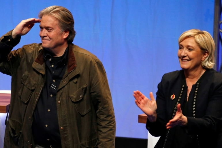 Marine Le Pen, National Front political party leader, and former White House Chief Strategist Steve Bannon attend the party's convention in Lille, France on March 10 [Pascal Rossignol/Reuters]