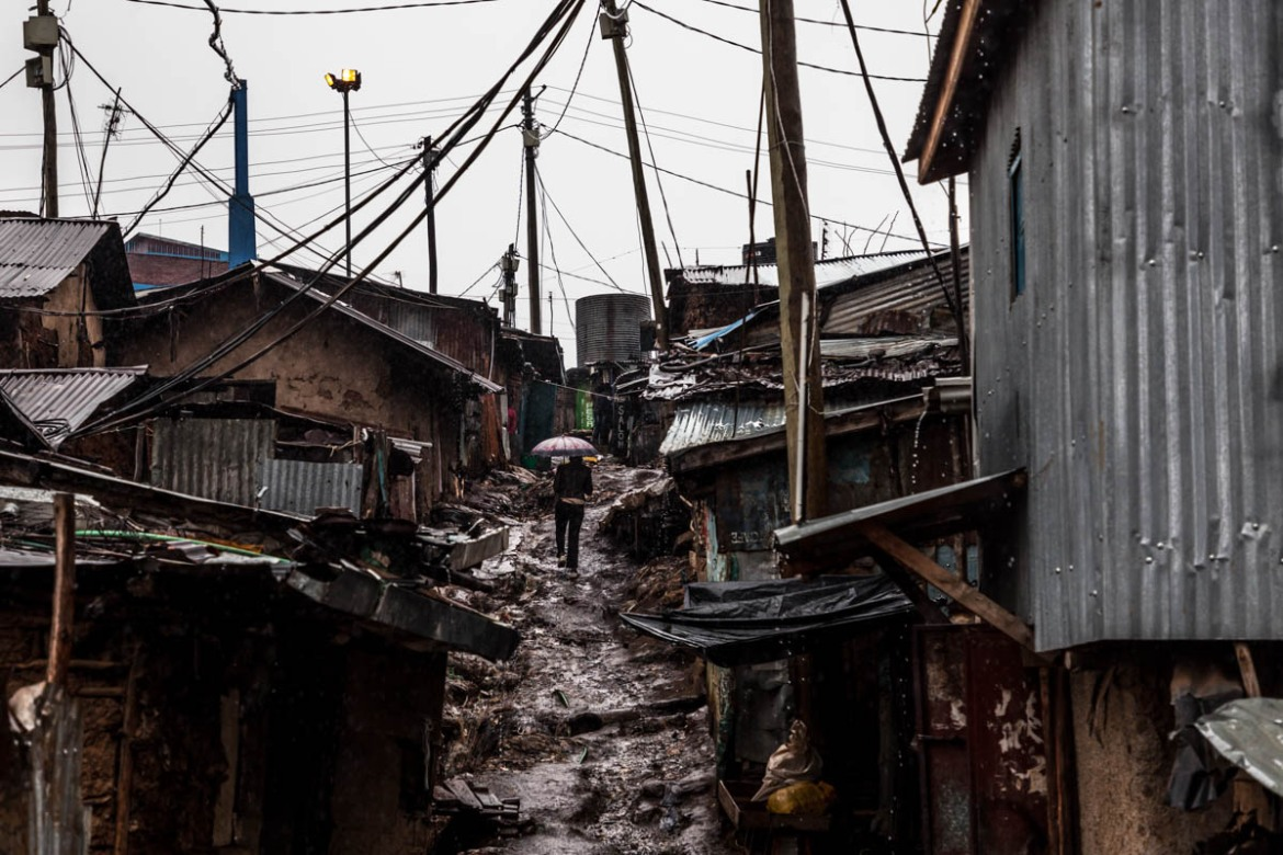 Inadequate infrastructure in informal settlements leaves much of the population to struggle alone for their basic needs. In Kibera, the residents come home to a place without sewage system, rubbish pick-up and adequate drainage channels. [Natalia Jidovanu/Al Jazeera]