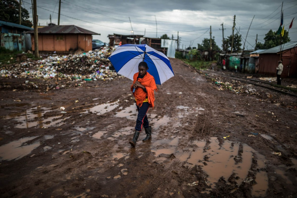 Dirty waters remain stagnant in most streets through the slum during the rainy season, posing a greater risk to the health of the residents. Children are often the most vulnerable to waterborne diseases caused by sewage contamination and environmental deterioration. [Brian Otieno/Al Jazeera]