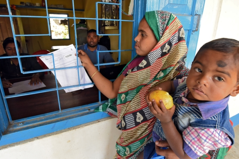 Critics say the move to strip the citizenship of Bengali origin people is similar to Myanmar's removal of rights and protections for its Rohingya community [Anuwar Hazarika/Reuters]