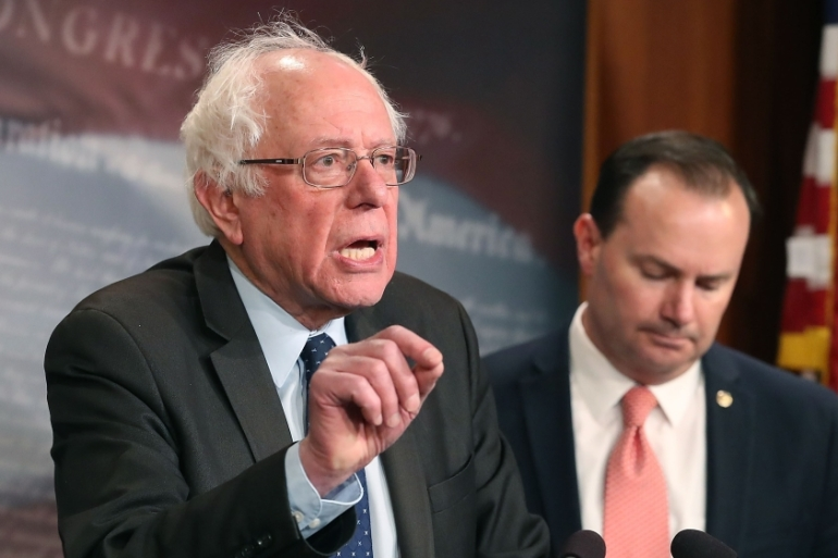 Bernie Sanders, left, and Mike Lee introduced the joint resolution to remove US forces from hostilities in Yemen war [Mark Wilson/Getty Images/AFP]