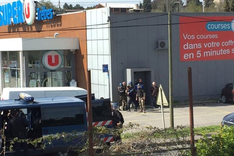 Police are seen at the scene of a hostage situation in a supermarket in Trebes [La Vie a Trebes/Reuters]