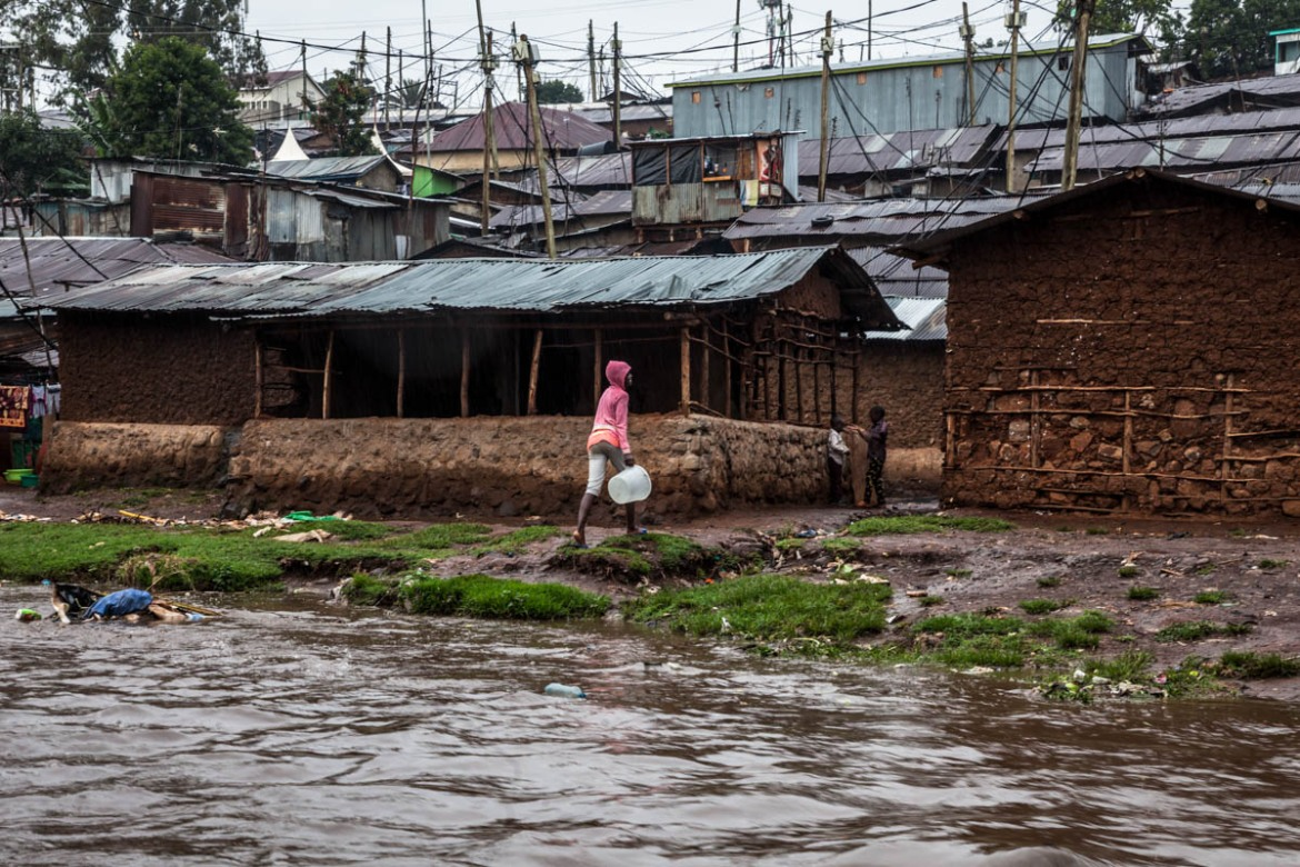 The poorest Kiberans are forced to build homes atop the banks of the river. This is the area of the slum where the impact of the floods is more severe. During the rainy season, the river overflows, inevitably destroying homes and claiming lives. [Brian Otieno/Al Jazeera]