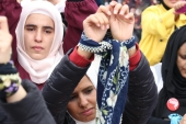 Female demonstrators tie their hands to attract attention to the plight of Syrian women in prisons [File: Reuters]