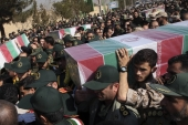 Civilians and armed forces members carry the flag-draped coffin of IRGC's Gen Mohsen Ghajarian killed in Syria during his funeral in Tehran on February 6, 2016 [AP/Vahid Salemi]