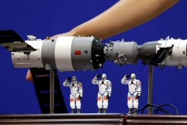 A model of the Tiangong-1 was displayed during a news conference at Jiuquan Satellite Launch Center in June, 2012 [Jason Lee/Reuters]