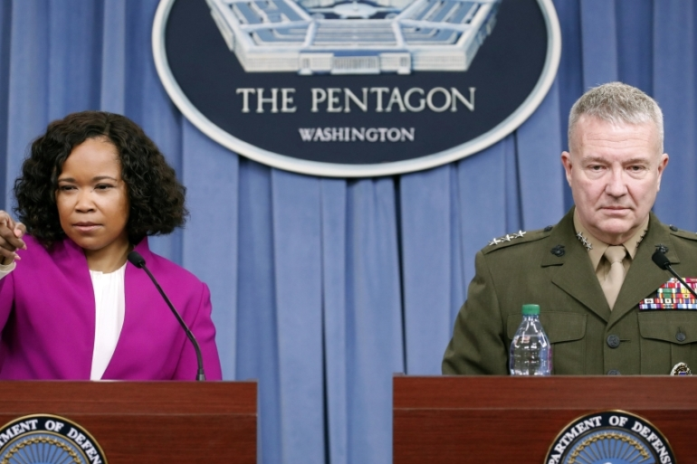 Kenneth F Mckenzie, right, says US and allies deployed 105 missiles against targets in Syria [Alex Brandon/AP]