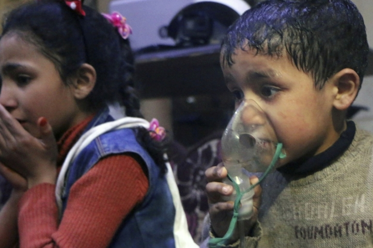 This image released b the Syrian Civil Defence White Helmets, shows a child receiving oxygen through respirators following an alleged poison gas attack in Douma, near Damascus, Syria [AP]