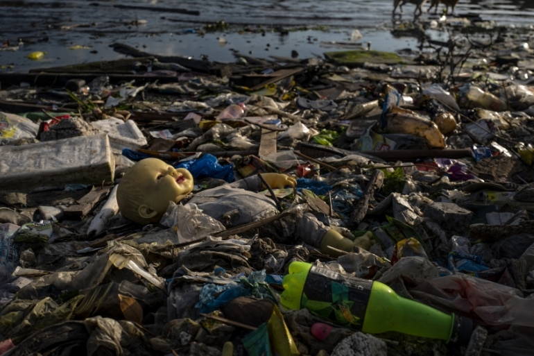 Plastic waste fills a beach in Manila, Philippines [AP]