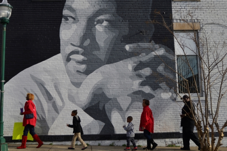People gather to march in the annual parade down MLK Boulevard to honour Martin Luther King, in Chattanooga, Tennessee, US [Reuters]