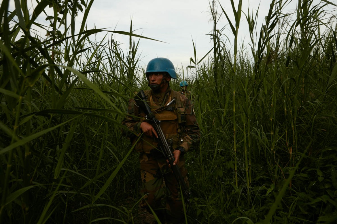 A UN peacekeeping mission patrols the outskirts of Kafe - a village which lies on the shores of Lake Albert, Ituri. The Hema village was rendered a ghost town after apparent Lendu attacks caused the residents to seek safety in other parts of the region as well as nearby Uganda. [Alex Mcbride Wilson/Al Jazeera]