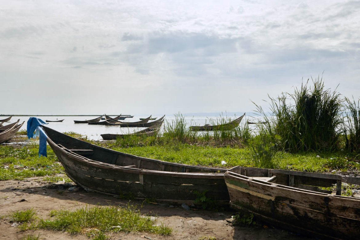 Fishing boats on the shores of Kasenyi in Ituri province. Boats like these have been used by Hema to flee to Uganda after the violence started in Djugu territory. The poor condition of the boats has meant that it has taken some refugees up to 10 hours to cross the lake, while several others have drowned in their attempts to make the crossing. [Alex Mcbride Wilson/Al Jazeera]
