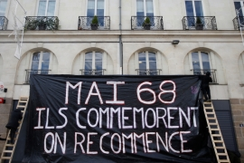 "Protestors display a banner which reads ''May 1968, they commemorate, we start again"" during a demonstration against French government reforms in Nantes, France, 2017 [Stephane Mahe/Reuters]"