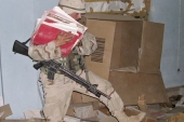 A US soldier hauls documents during a raid conducted at a community centre in Baghdad in June 2003 [AP/Jim Krane]