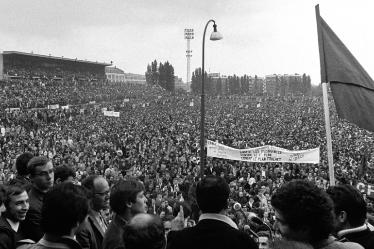 Workers and students gather at Stade Sebastien Charlety in Paris on May 27, 1968 [AP Photo]