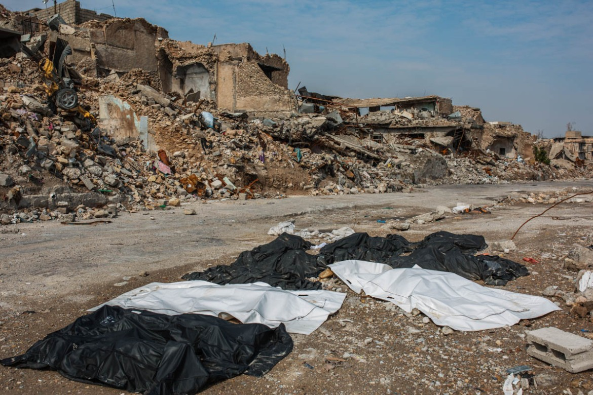 Some corpses of people who died during the battle in Mosul in 2017 left for more than a week in the Old City of Mosul. [Alessio Mamo/Al Jazeera]