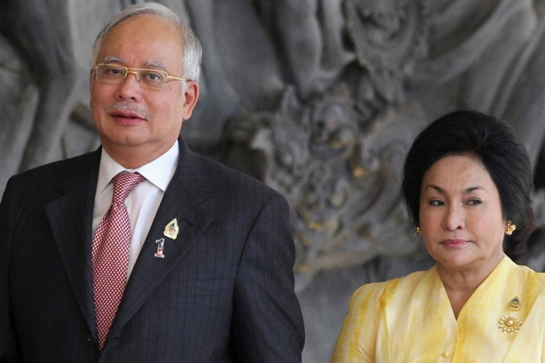 Najib Razak and his wife Rosmah Mansor said they wanted to go on holiday for a post-election break [File: Stephen Morrison/Reuters]