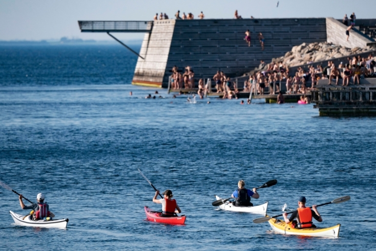 People enjoy the cool water in Malmo, southern Sweden, during the record-breaking month of May [Johan Nilsson/TT via AFP]
