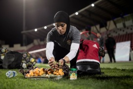 Jordanian forward Anfal al-Sufy, 22, shares the green almonds and loquats, which she brought from her mother's garden. [Maja Hitij/Bongarts/Getty Images]