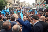 Lebanon's Prime Minister Saad Hariri takes selfies during an election campaign in Tripoli, Lebanon April 27, 2018 [Dalati Nohra/Reuters]