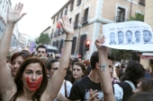 Protests were held across Spain after five men accused of the gang rape of a teenager in Pamplona were found guilty of the lesser offence of sexual abuse [Reuters]