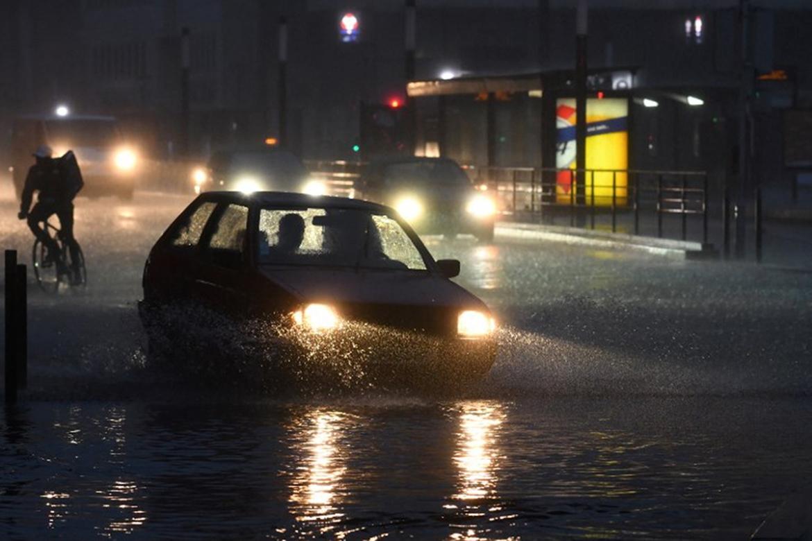 Flooding hits Le Mans. There were 204,000 lightning strikes in France in May, beating the previous record of 85,000 in 2009. [Jean-Francois Monier/AFP]