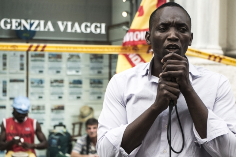 Aboubakar Soumahoro speaking at a rally for housing rights in Rome on June 20 [Ylenia Gostoli/Al Jazeera]