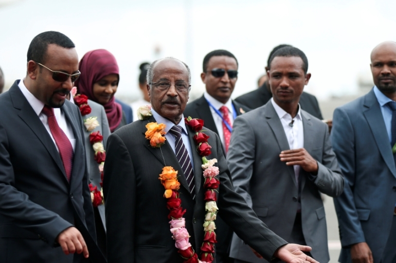 Ethiopia's Prime Minister Abiy Ahmed, left, welcomes the Eritrean delegation [Tiksa Negeri/Reuters]