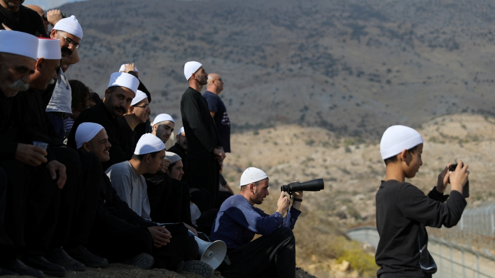 Druze gather to contact their relatives on the Syrian side, in the Israeli-occupied Golan Heights [File: Reuters]